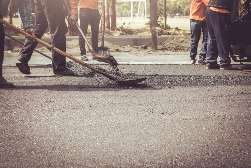 Workers digging road